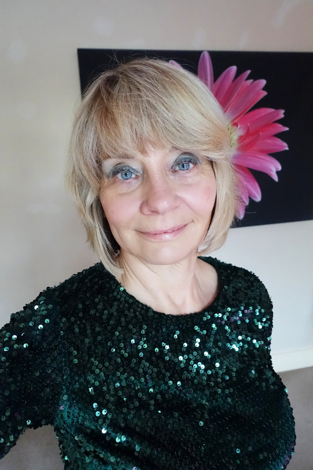 A dramatic green sparkly eyeshadow from Huda Beauty Emerald palette worn by over-50s blogger Gail Hanlon