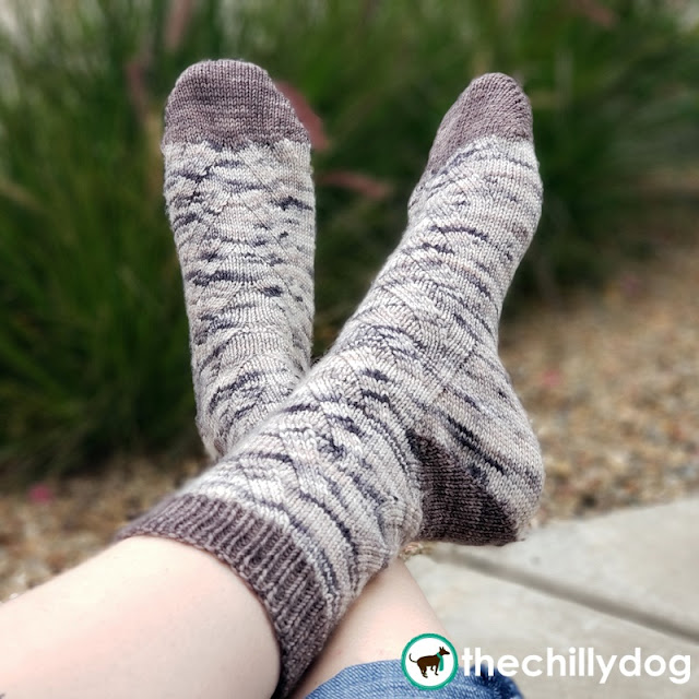 Free Climber Socks Pattern designed by The Chilly Dog in Oink Pigments Yarn