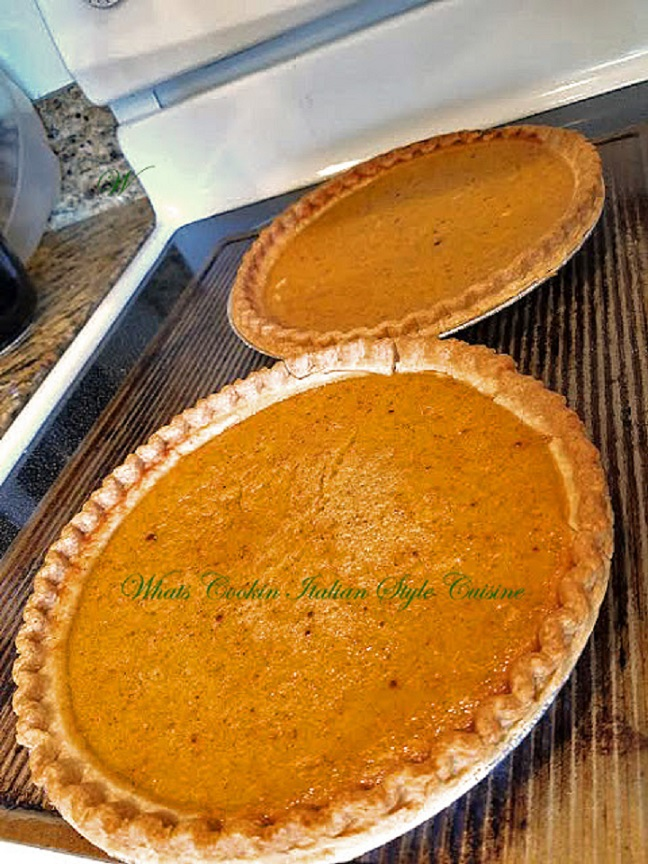 this is a photo of two baked pumpkin pies