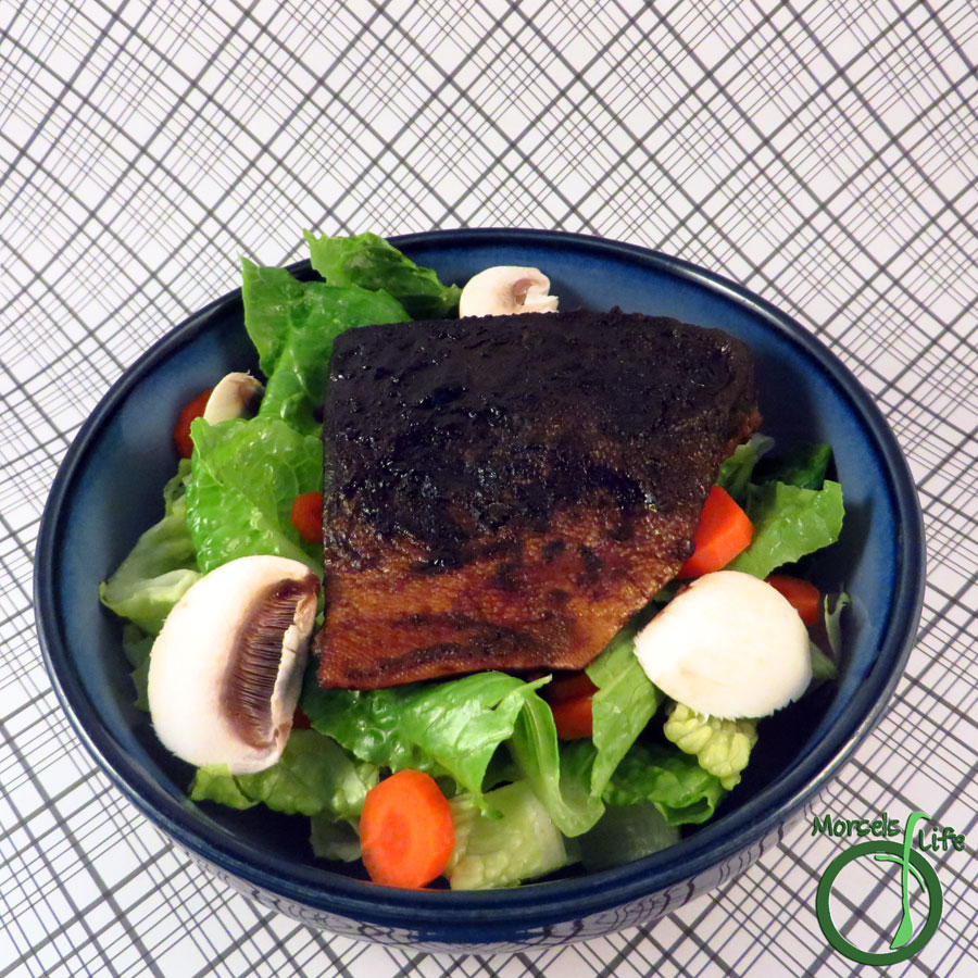 Morsels of Life - Asian Salmon Salad - Flavorful salmon, pan fried with garlic, ginger, soy sauce, and a bit of mustard, served over greens for an Asian Salmon Salad.