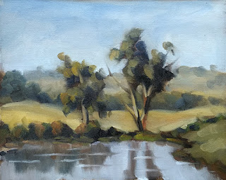 Landscape oil painting of two eucalypts beside a dam.
