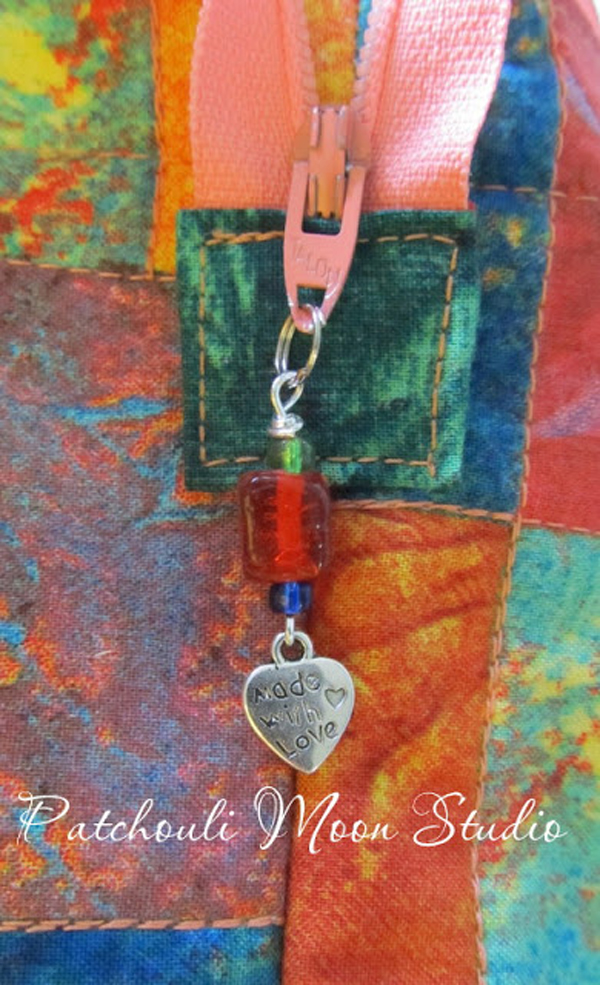Learn how to make a zipper pull with beads and a charm. Tutorial by Patchouli Moon Studio