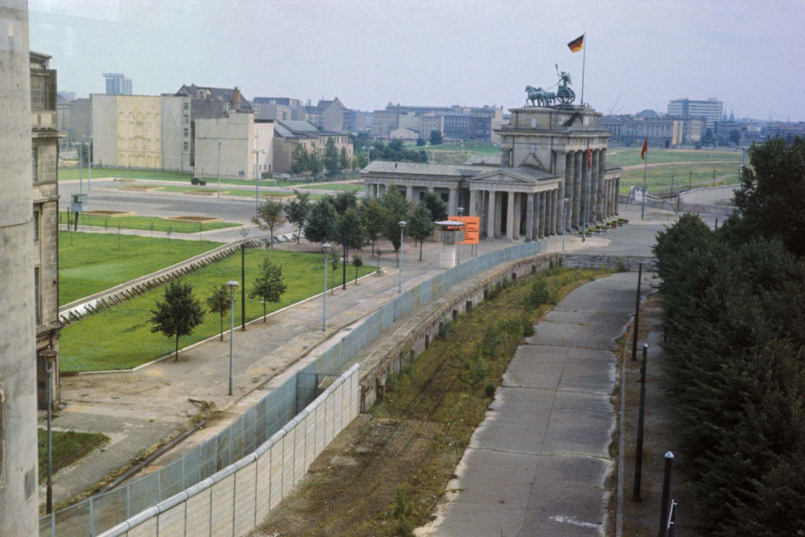 A photograph taken on August 10, 1966, of the system of walls, barriers, watchtowers, and an open