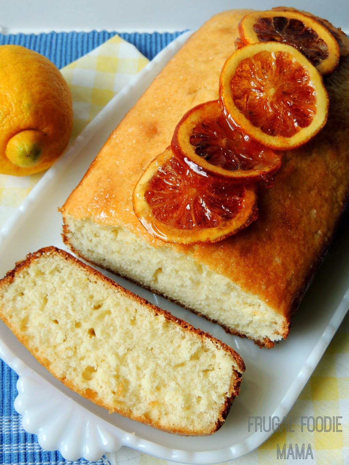 This Lemon Drop Bread with Candied Lemon Slices truly lives up to it's namesake. Moist, sweet bread with a hint of lemony tartness drizzled in a lemon-sugar glaze and topped with homemade candied lemon slices.