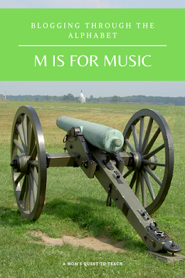 Blogging Through the Alphabet: M is for Music; Civil War Cannon in background