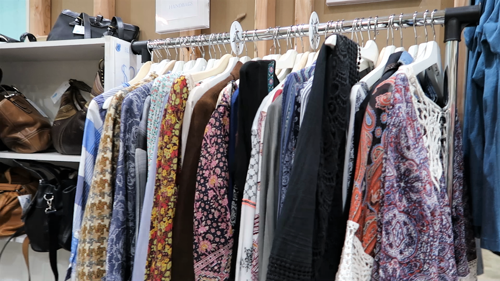 A Rack with thrift clothes at the Thrift store. Thrifting With Style: Looking through every rack for stylish secondhand clothes to wear and style.