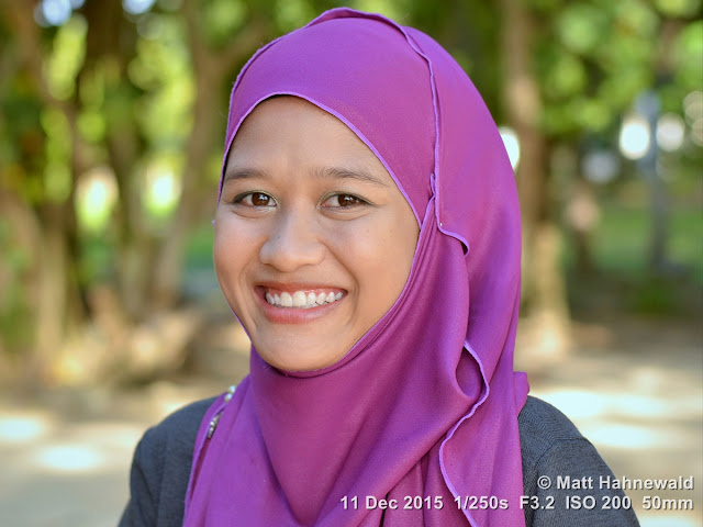 Matt Hahnewald Photography; Facing the World; closeup; street portrait; headshot; outdoor; Asia; Southeast Asia; Malaysia; Langkawi; Kuah; smiling; beautiful; Malay woman; hijab; red lips; posing; beach; makeup; stylish; 1Malaysia