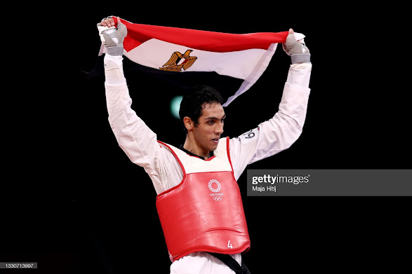 Seif Eissa holding the Egyptian flag high in Tokyo
