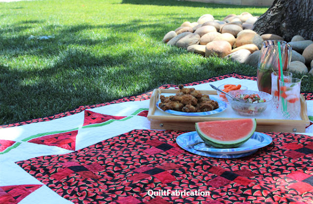 picnic lunch on the Watermelon Delight quilt by QuiltFabrication