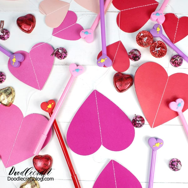 Hearts in reds, pinks and light pinks with pens, candy and Valentine day perfection!
