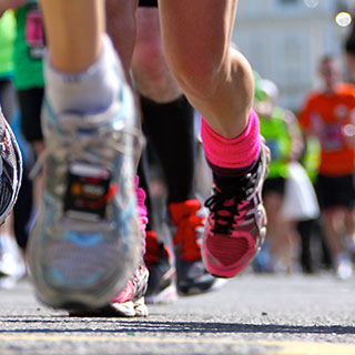 Runners running a marathon - Massage Therapy for Marathon Training – make it part of your routine - Academy Massage Therapy