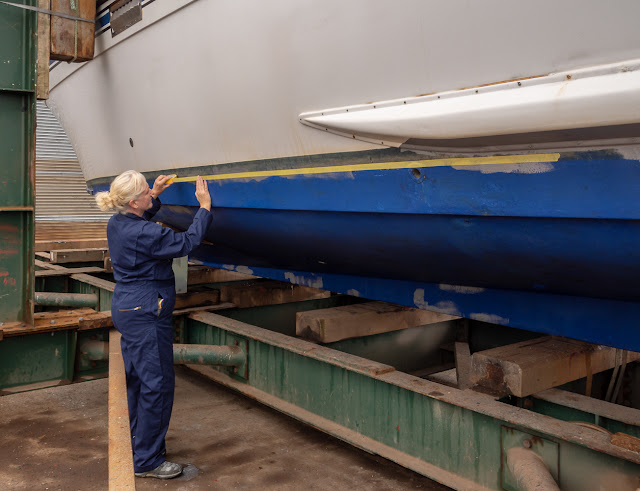 Photo of me taping Ravensdale's hull ready for painting