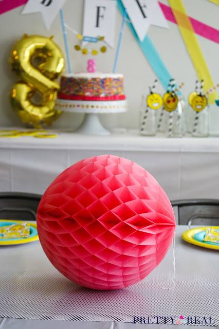 honeycomb balls as table decor at an emoji birthday party