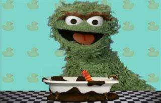 Oscar the Grouch states that Slimey took a mud bath. Sesame Street Elmo's World Bath Time Quiz
