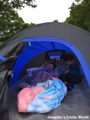 Children sleeping in a tent