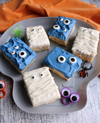 close up of serving tray filled with white mummy rice krispie treats and blue monster rice crispy treats