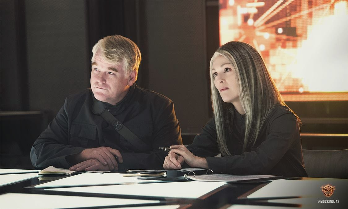 The Hunger Games Mockingjay Part 1 Plutarch and Alma Coin