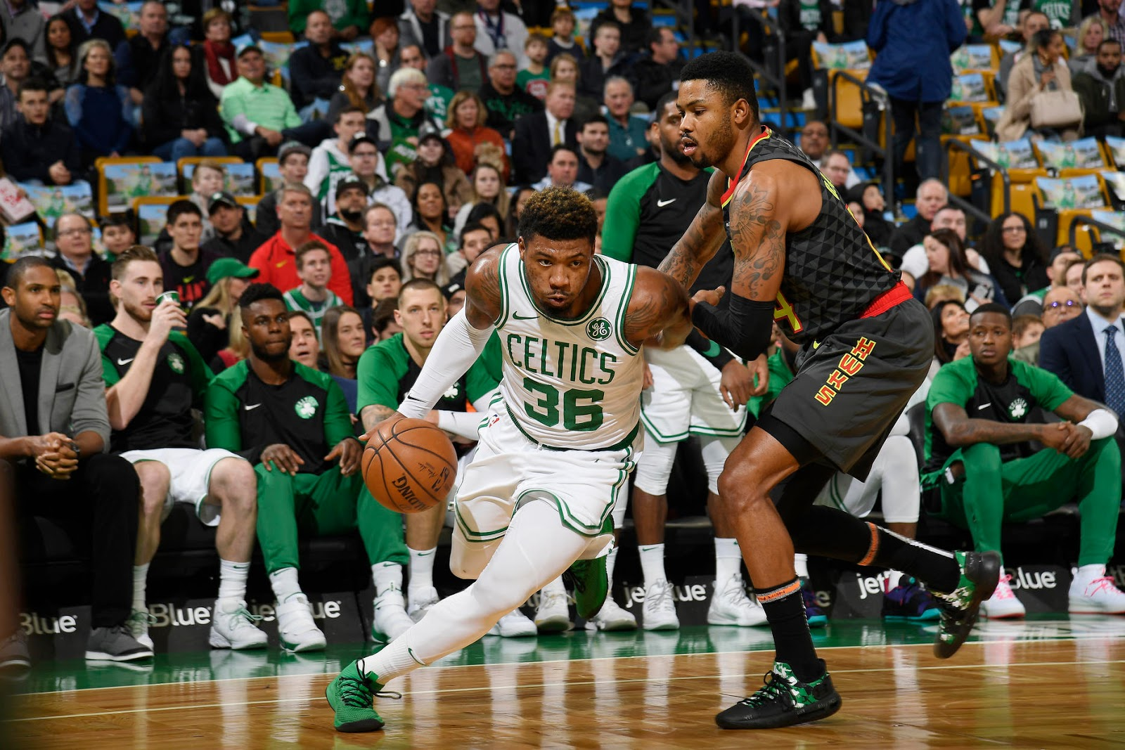Marcus Smart is running his camps, staying in shape, and still here