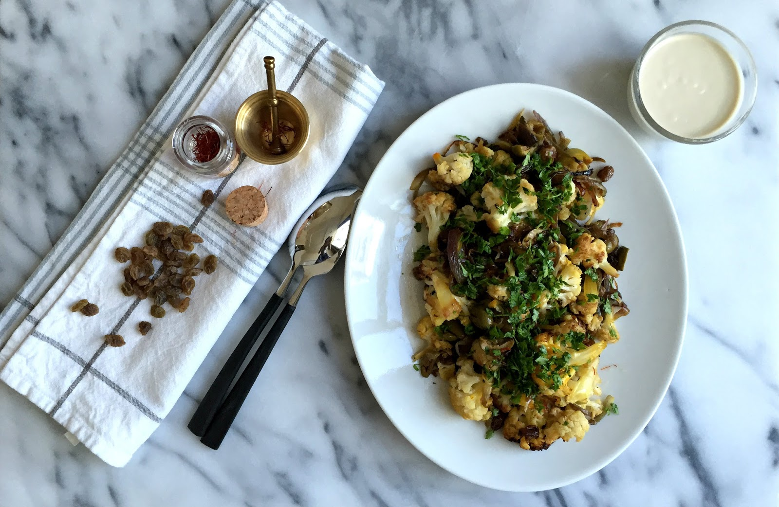 Saffron roasted cauliflower with olives and sultanas