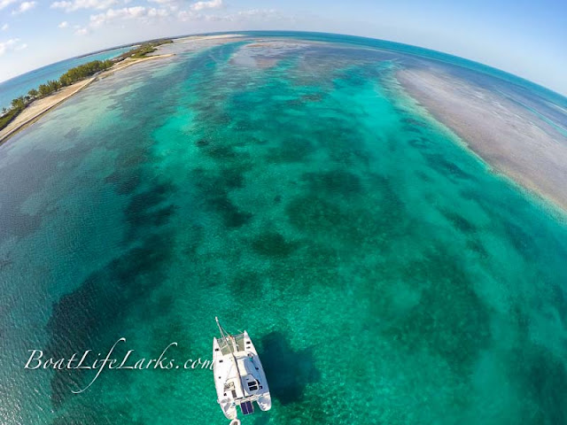 Drone shot: Lagoon 380 sail catamaran at anchor, Dollar Harbor, Bimini Islands, Bahamas