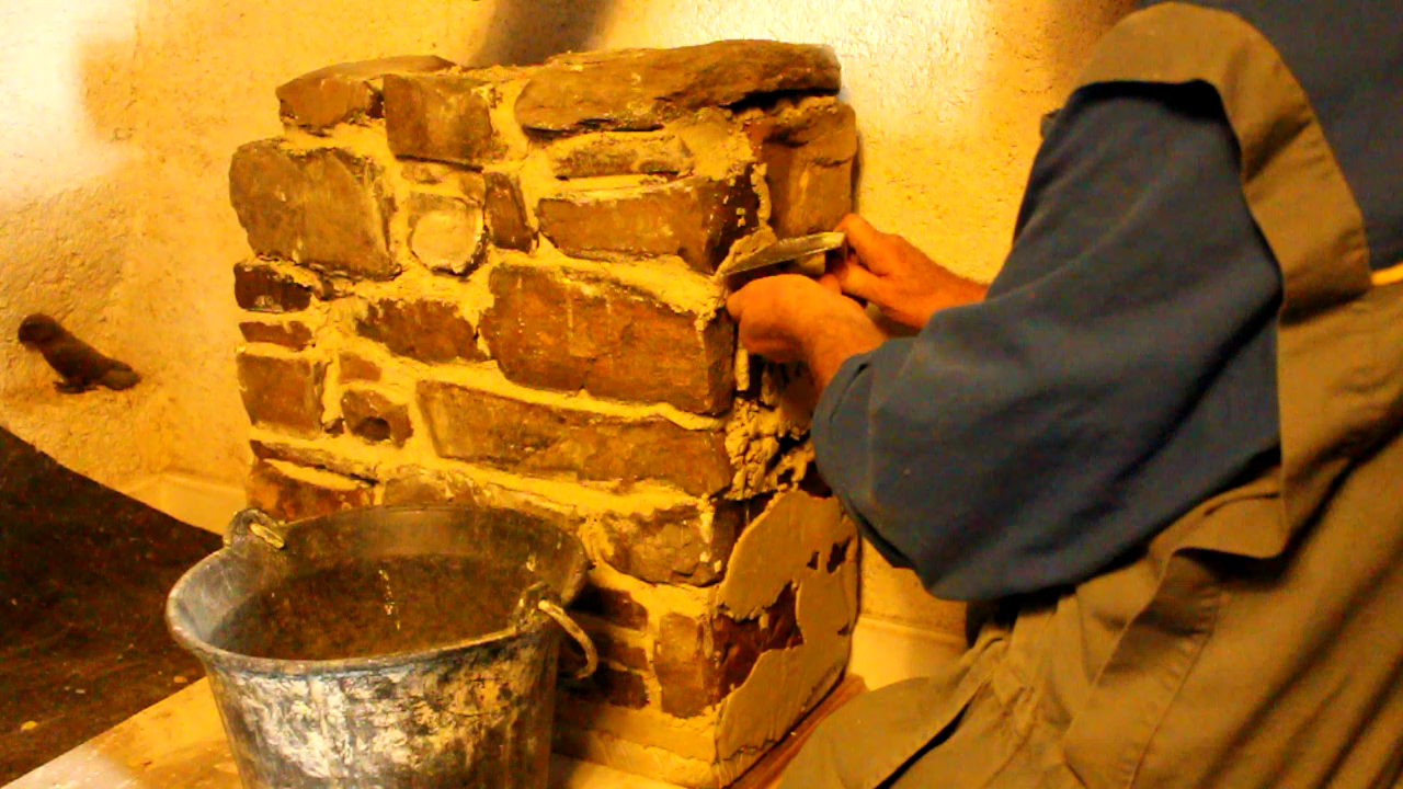Home-made storage heater removing excess lime mortar