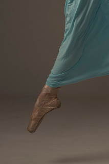 A Dance Model Showing a Fully Pointed Foot on Pointe