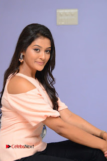 Actress Pooja Jhaveri Pictures in Jeans at Dwaraka Movie First Look Launch  0122.JPG