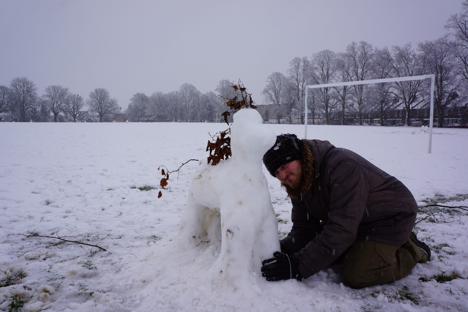 dad building a snow pony