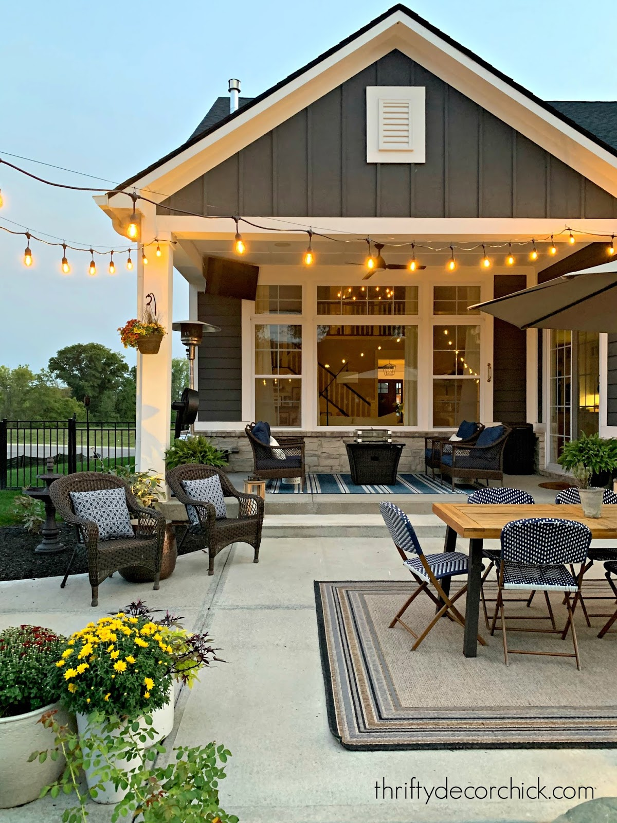 covered porch and patio with lighting