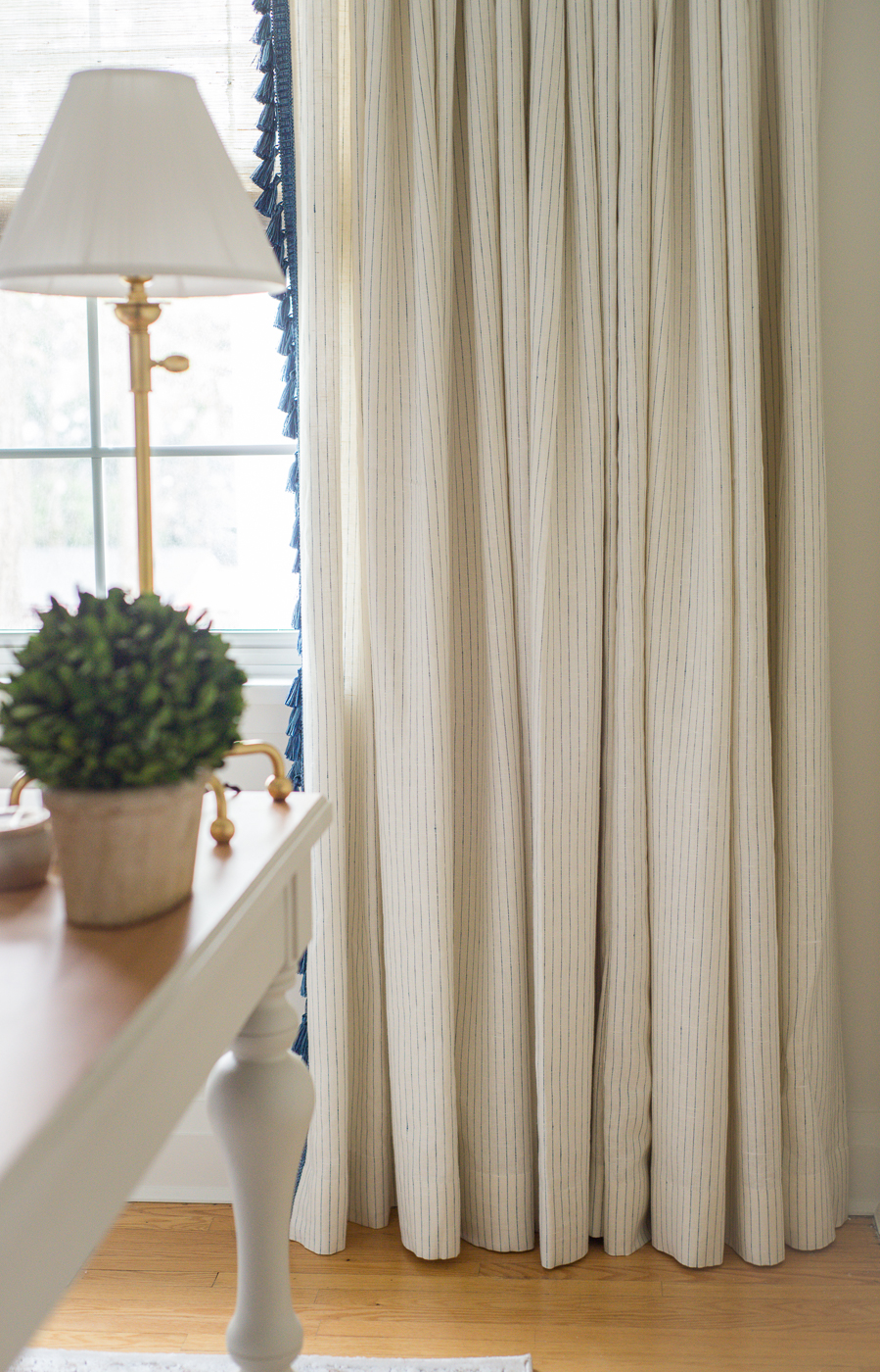 drapery with double pinch pleat, trim on leading edge, tassel trim leading edge, tassel trim on drapery