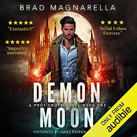 Demon Moon audiobook cover. A handsome wizard in a trench coat faces outward with his arms wide and palms splayed to reveal fiery sparks within each hand.