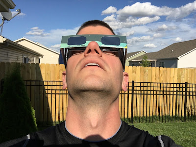 looking up at the sun with eclipse glasses