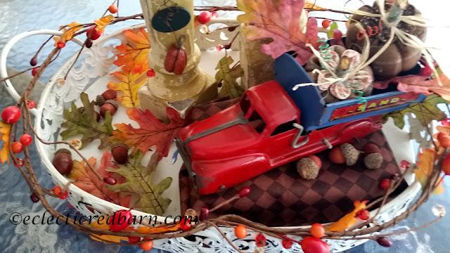 Pumpkins, Spindles, and Vintage Truck Share NOW. #falldecor. #fallvignette #pumpkins #vinatge #eclecticredbarn