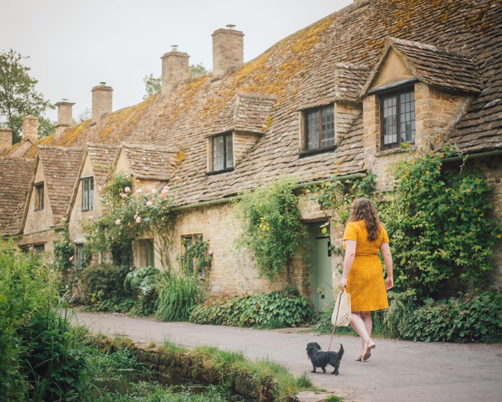 cotswolds instagram spot arlington row bibury dachshund liquid grain