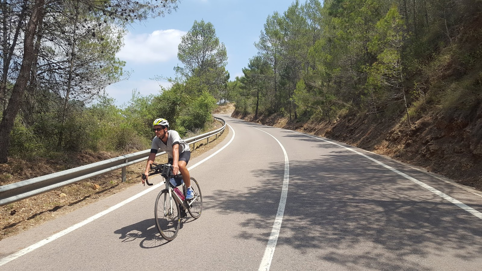 Cyclist descending wooded climb in Castellón, Spain