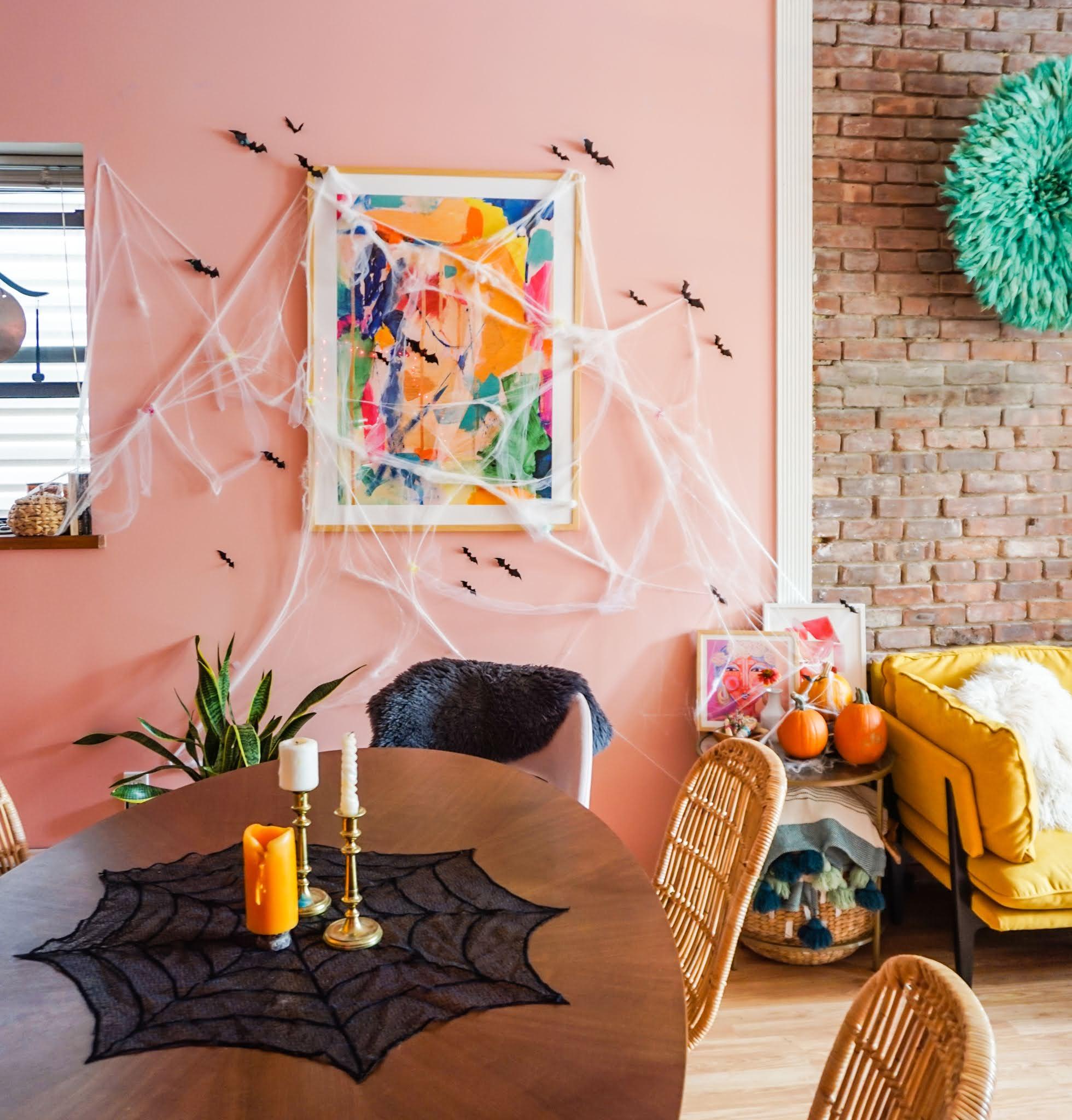 colorful halloween decor // easy halloween decor // halloween decor // halloween bats // halloween cobwebs // halloween tables cape // kid-friendly halloween decor // halloween decor with color // boho halloween decorations // bright and colorful halloween decor // electic  halloween decor // cute halloween decor // color halloween decor // tiny bats halloween decor // how to decorate for halloween in 2020 // simple halloween decorations