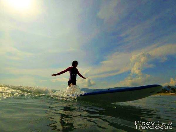 Nikki surfs a la Christ the Redeemer