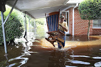 Days of rain from Hurricane Florence flooded homes across a wide area of North Carolina in September 2018. In Spring Lake, nearly 100 miles from the coast, Bob Richling carried items from a home as the Little River flooded. (Credit: Joe Raedle/Getty Images) Click to Enlarge.
