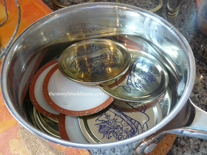 lids in a pan of hot water