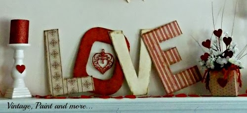 "center of mantel with word ""love"" , flowers and candle"