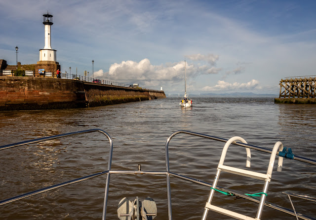 Photo of Ravensdale following a yacht out between Maryport's twin piers