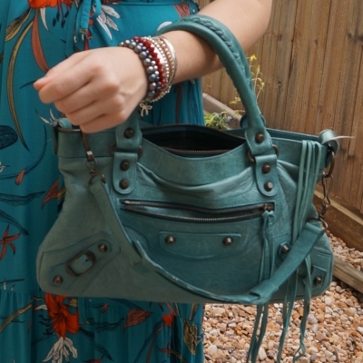 teal dress with bracelet stack and Balenciaga first bag in 2006 Blue India | away from the blue