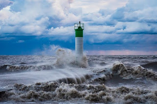 Lighthouse in Storm - Photo by Michael Krahn on Unsplash