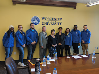Worcester State students pose with members of the Higher Education committee before touring the WSC campus on Friday, Nov 1