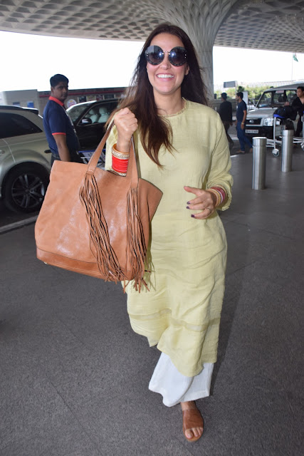 Newly-wed Neha Dhupia is all smiles at the airport