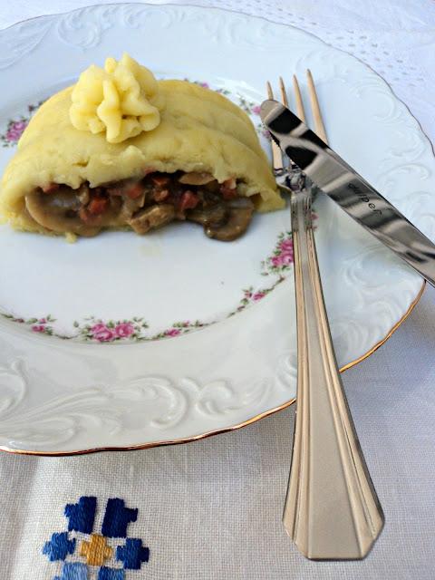 Brazo de gitano, pastel de patatas y setas con jamón