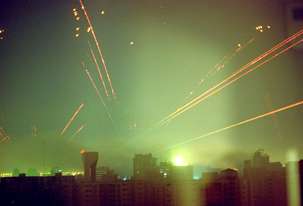 The sky above Baghdad is filled with anti-aircraft fire as U.S. warplanes attack Iraq's capital on the morning of January 18, 1991.