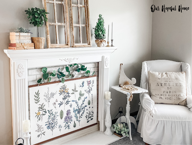 shabby chic bedroom faux fireplace botanical poster wing chair