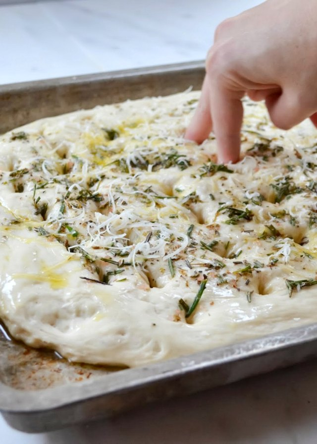 Herbed Focaccia Bread recipe press indentations into dough from Serena Bakes Simply From Scratch.