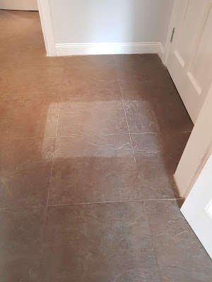Photo of a demonstration patch, cleaned of a porcelain ceramic tiled floor